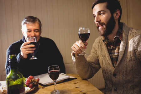 wine country: Mature and hipster man tasting red wine in country house
