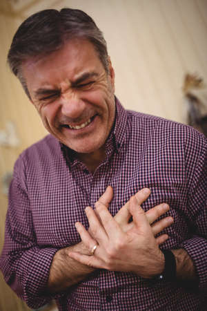 infarct: Mature man is doing an infarct in his house LANG_EVOIMAGES