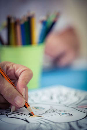 coloring sheets: Focus on foreground of hand colouring in the retirement house