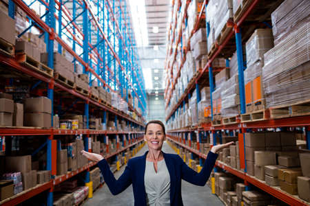 half length: Half length of warehouse manager in the aisle