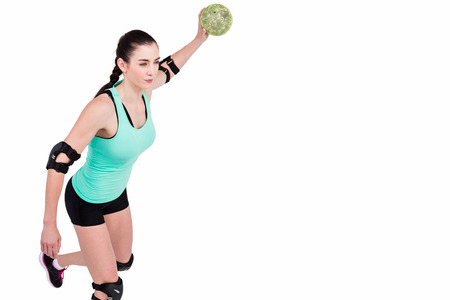 elbow pad: Female athlete with elbow pad throwing handball on white background Stock Photo