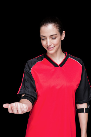 elbow pad: Female athlete posing with elbow pad  on black background
