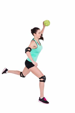 female elbow: Female athlete with elbow pad throwing handball on white background Stock Photo