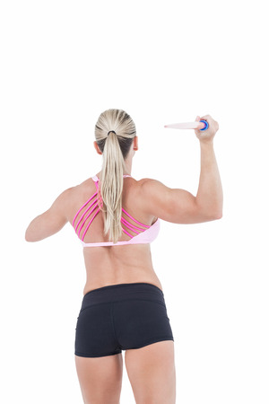 javelin: Female athlete throwing a javelin on white background Stock Photo