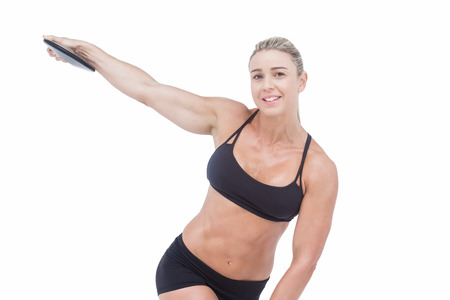 discus: Female athlete throwing discus on white background Stock Photo