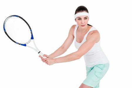 athleticism: Female athlete playing tennis on white background