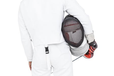 swordsman: Rear view of swordsman holding fencing mask and sword on white background