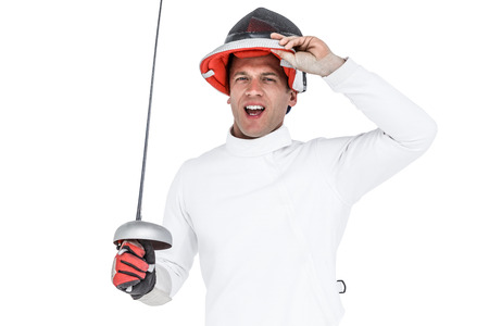 fencing sword: Portrait of man wearing fencing suit practicing with sword on white background