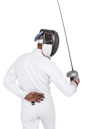 fencing sword: Rear view of man wearing fencing suit practicing with sword on white background