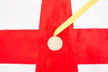drapeau anglais: Close-up de la m�daille d'or sur le drapeau anglais
