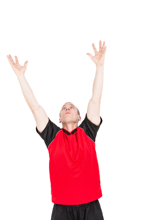 cut the competition: Sportsman posing while playing volleyball on white background Stock Photo