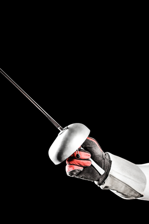 fencing sword: Close-up of swordsman holding fencing sword on black background Stock Photo