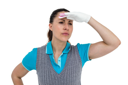 shielding: Close-up of golf player with shielding eyes in white background Stock Photo