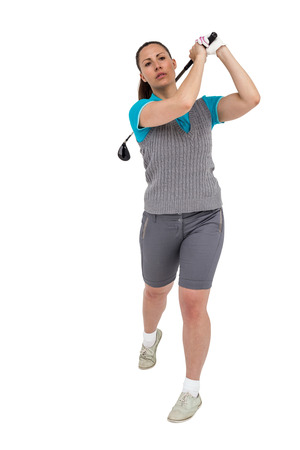 short gloves: Golf player taking a shot on white background Stock Photo