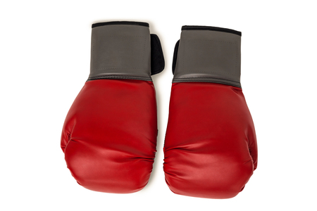 cut the competition: Boxing gloves isolated on white background