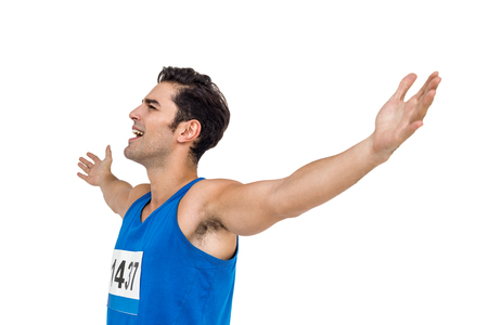 male athlete: Excited male athlete with arms outstretched after victory on white background Stock Photo