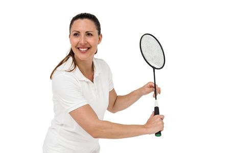 badminton racket: Female player playing badminton on white background
