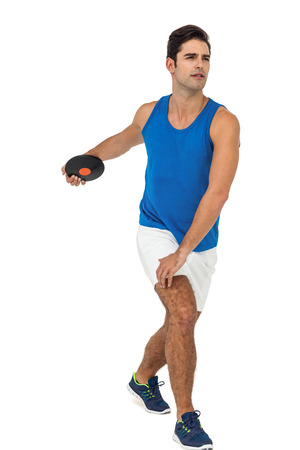 lanzamiento de disco: Determined male athlete playing discus throw on white background