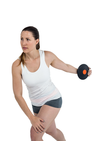 discus: Determined female athlete playing discus throw on white background