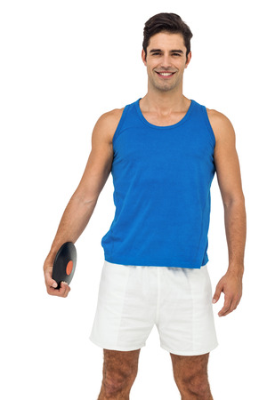 lanzamiento de disco: Happy male athlete posing with discus throw on white background