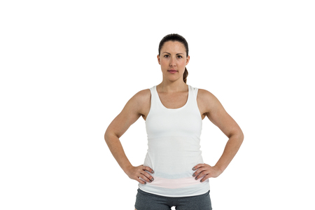 cut the competition: Portrait of female athlete standing with hands on hips on white background