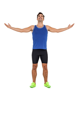 outstretched: Athlete man standing with arms outstretched on white background