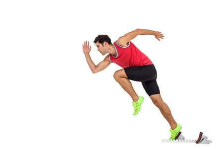 starting blocks: Confident male athlete running from starting blocks on white background Stock Photo
