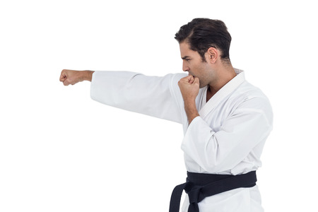 punched out: Fighter performing karate stance on white background Stock Photo