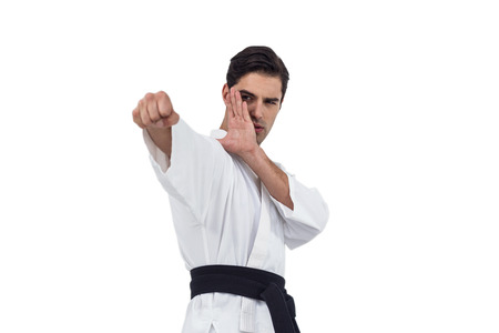 performing: Fighter performing karate stance on white background Stock Photo