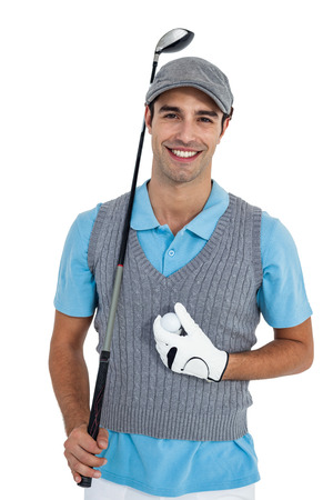 Portrait of golf player standing with golf ball and golf club on white background Banco de Imagens