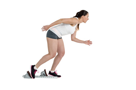 starting blocks: Confident athlete woman running from starting blocks on white background