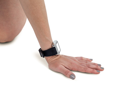 wrist watch: Close-up of athlete woman hand with wrist watch on white background