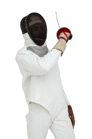 fencing sword: Man wearing fencing suit practicing with sword on white background