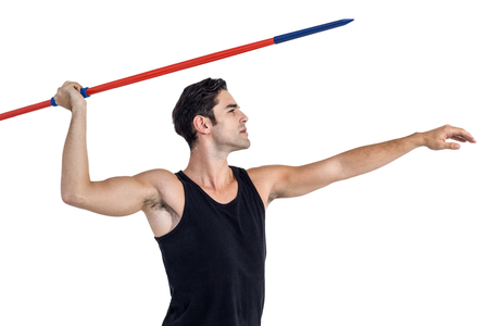 cut the competition: Male athlete preparing to throw javelin on white background