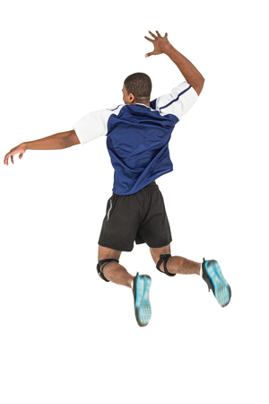 cut the competition: Rear view of sportsman posing while playing volleyball on white background Stock Photo