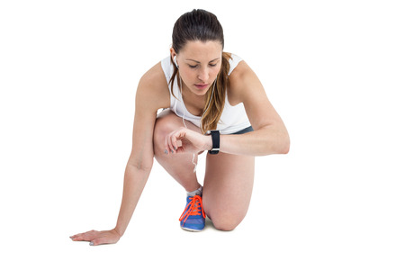 cut wrist: Athlete woman in ready to run position on white background