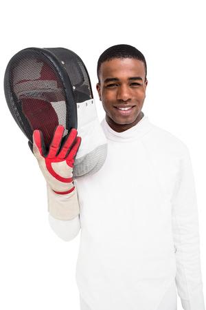 swordsman: Portrait of swordsman holding fencing mask on white background