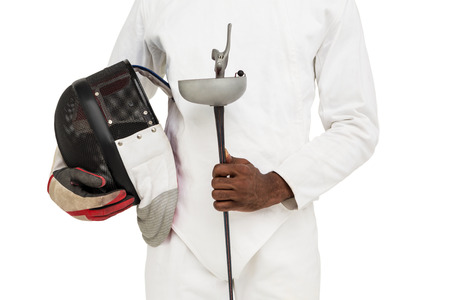 fencing sword: Mid-section of man standing with fencing mask and sword on white background