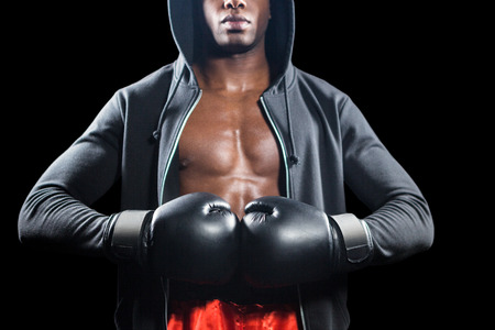 mid section: Mid section of muscular boxer on black background Stock Photo