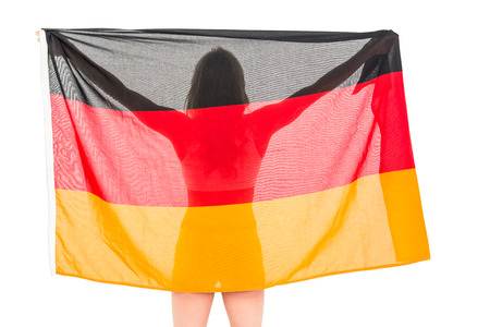 german flag: Athlete posing with german flag after victory on white background Stock Photo
