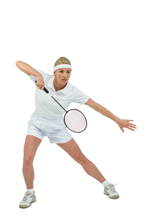 badminton racket: Badminton player playing badminton on white background
