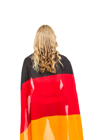 german flag: Athlete posing with german flag wrapped around his body on white background