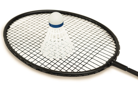 cut the competition: Badminton racket with feather shuttlecock on isolated white background