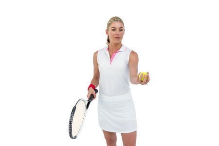 racquet: Athlete holding a tennis racquet ready to serve on white background