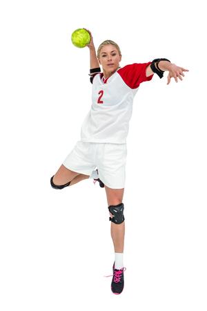 Sportswoman throwing a ball on white background Stock Photo