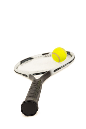 cut the competition: Tennis ball and racket on isolated white background