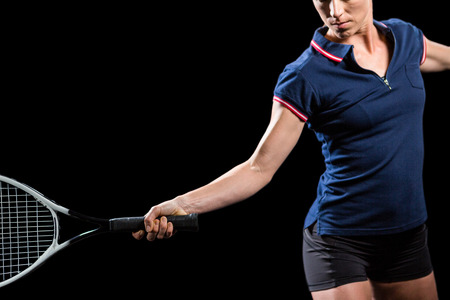 cut the competition: Tennis player playing tennis with a racket on black background