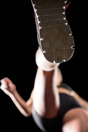 Sole of a athletics training shoes on black background Stock Photo