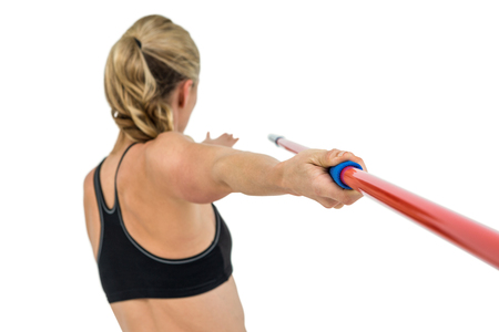 cut the competition: Athlete preparing to throw javelin on white background Stock Photo