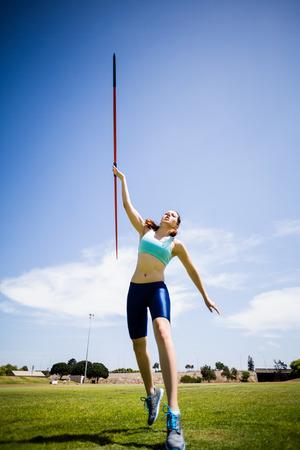 javelin: Female athlete throwing a javelin